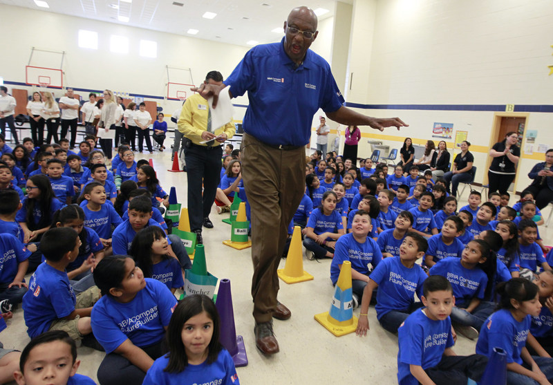 NBA Legend Bob Lanier towers over students at Victor Fields Elementary School before the start of a BBVA Compass/WNBA Cares event in McAllen, Texas, on April 6 to promote financial literacy. (NOTE TO USER: User expressly acknowledges and agrees that, by downloading and/or using this Photograph, user is consenting to the terms and conditions of the  Getty Images License Agreement. Mandatory Copyright Notice: Copyright 2017 NBAE (Photo by Nathan Lambrecht/NBAE via Getty Images)