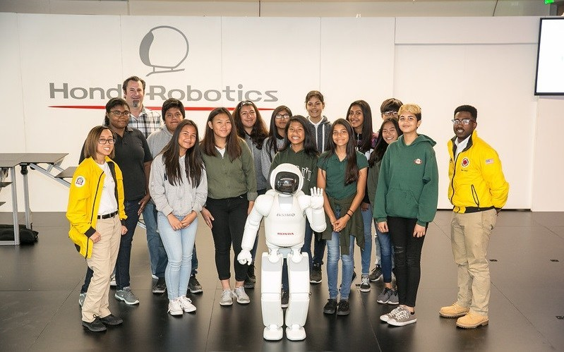 City Year students pose with Honda's ASIMO humanoid robot at a recent STEM education event.