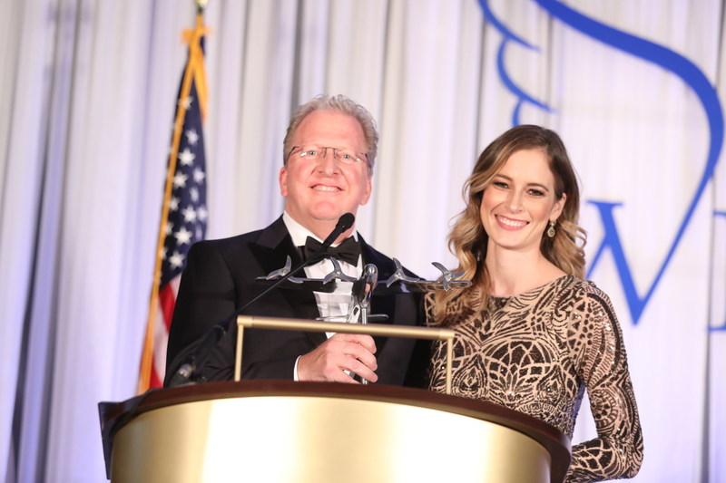 Doug Abercrombie, Chief Agency Officer at Combined Insurance, pictured with Lindsay Gill, Executive Director of Business Development and Corporate Sponsorships at Luke's Wings, accepts Community Impact Award at the 6th Annual Heroes Gala in Washington., D.C.