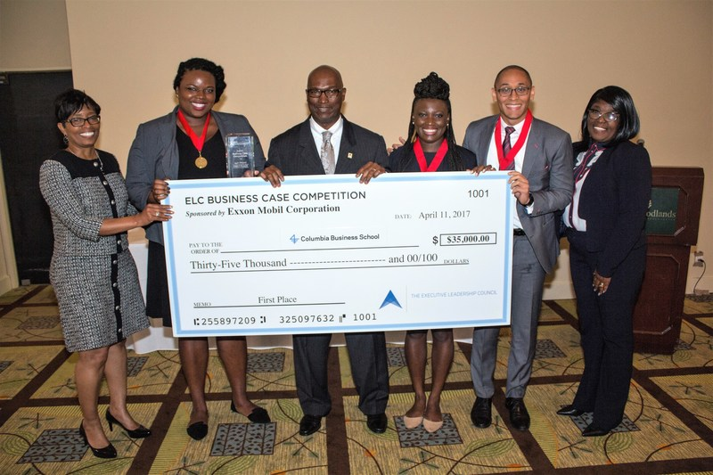 The Executive Leadership Council (ELC) 2017 Business Case Competition winning team from Columbia Business School, Team Captain Eddwina Bright (2nd from left), Alryl Koroma (3rd from right), and Durrell Mack (2nd from right), join representatives of sponsor ExxonMobil JoAnn Lee (l.) and Elijah White (3rd from left), and The ELC's Senior Director/Chief Program Officer Camilla McGhee (r.) to display a big check with their award.