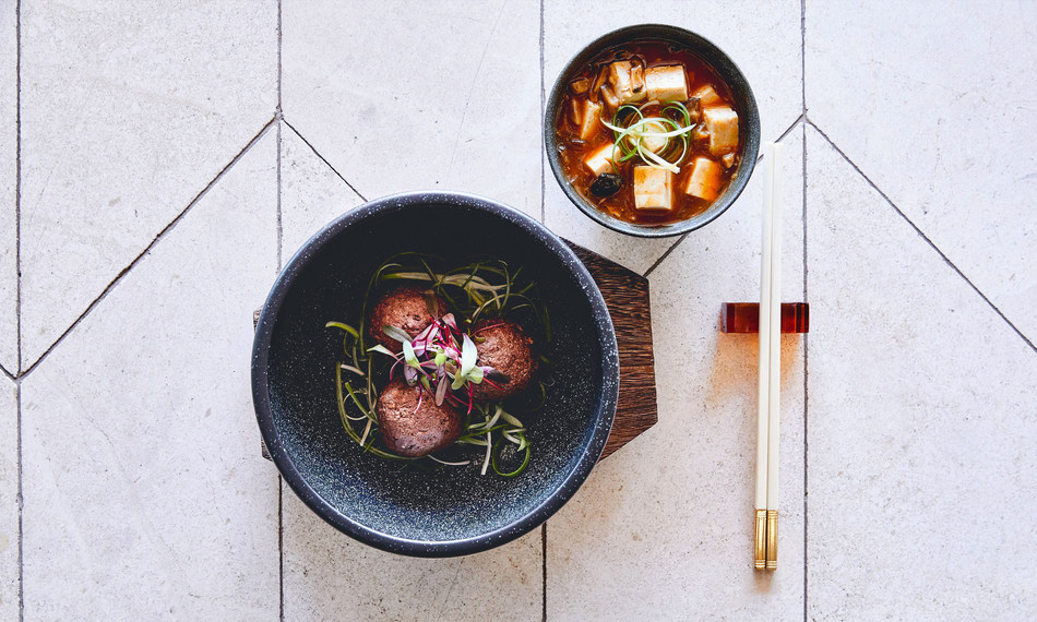 Ma Po Tofu, a unique take on meatballs made with Impossible Burger meat, chili paste, shiitake mushrooms and green onion.