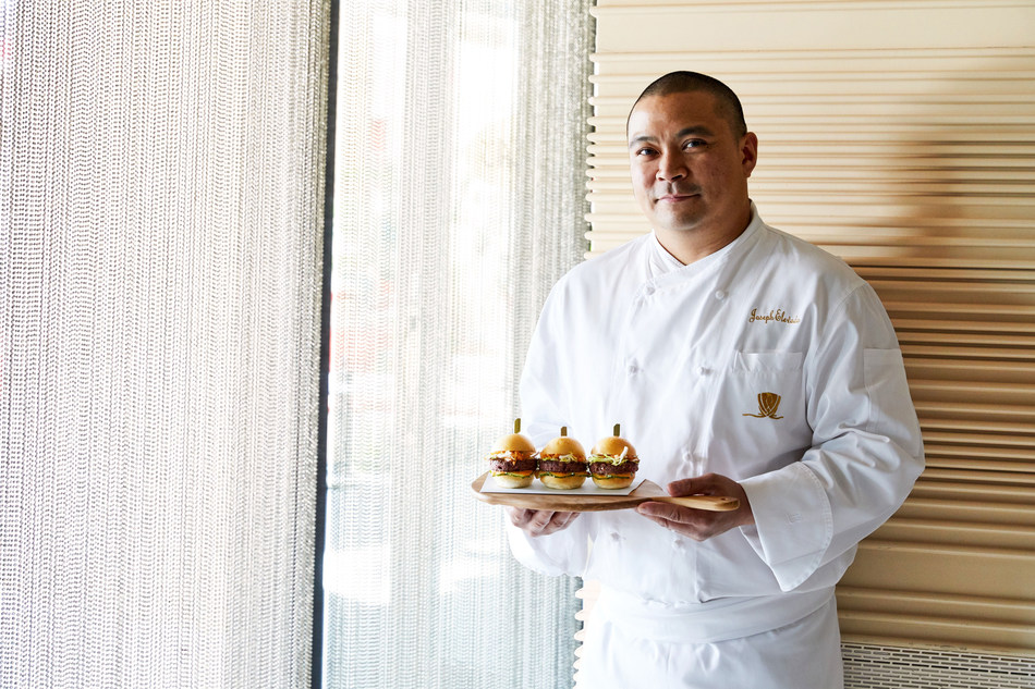Joseph Elevado, Executive Chef of Andrea's, the award-winning fine dining restaurant at Wynn Las Vegas, shows off his Kalbi Glazed Impossible Burger sliders, topped with frisée, kimchee, cucumber and gochujang aioli.