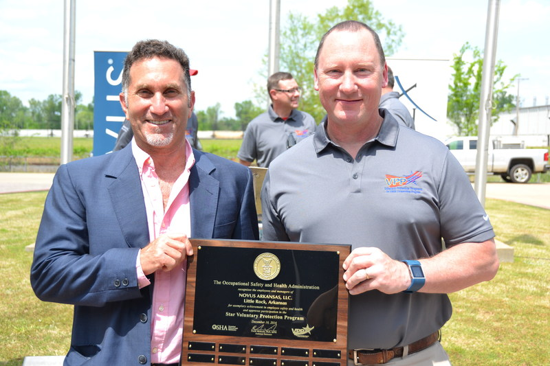 Sal Romito, Novus Director of Manufacturing-Methionine Business Unit, and John Farmer, Executive Plant Manager of Novus Arkansas accept the OSHA VPP Star Award.