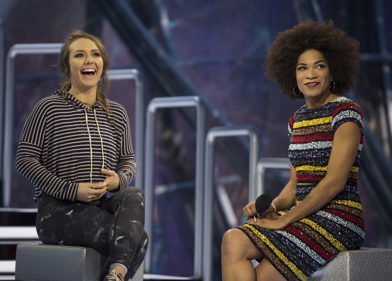 Emily Hawkin of Toronto, Ont. watches her goodbye messages with host Arisa Cox on stage after her eviction (CNW Group/Global Television)