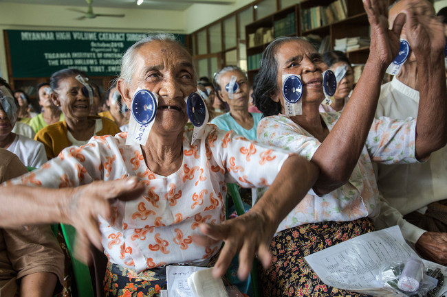 Two elderly patients celebrate after their sight was restored in Myanmar. Photo: Michael Amendolia