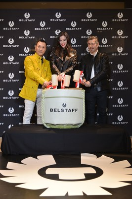 "Liv Tyler, Belstaff CEO Gavin Haig, and CEO of Japan Hajime Takuwa, performing 'Kagame Biraki' - the smashing open of a Sake barrel - a traditional Japanese ceremony literally meaning ""Opening a mirror to the future"" in celebration of the launch of Belstaff's Tokyo flagship store in the latest incredible retail development of the city, Ginza Six. (PRNewsfoto/Belstaff)"
