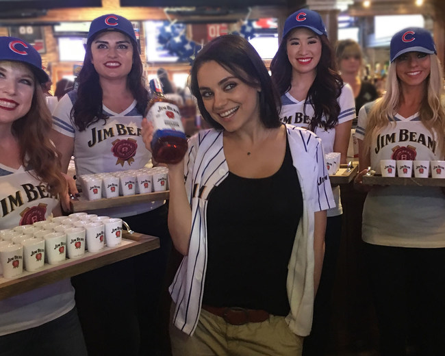 """Jim Beam® Bourbon brought Mila Kunis to The Cubby Bear and other iconic Wrigleyville bars on Saturday April 15, 2017 to surprise fans with a toast to the season and a preview of the new limited edition Jim Beam® """"Game 7 Batch,"""" a hand selected batch of bourbon that completed its 4 years of barrel maturation the history making date of the Cubs' Game 7 World Championship game last fall."""