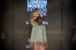 The world's first hijabi model Halima Aden leads on catwalk for Turkish swimwear designer Mayovera at Modanisa London Modest Fashion Week
