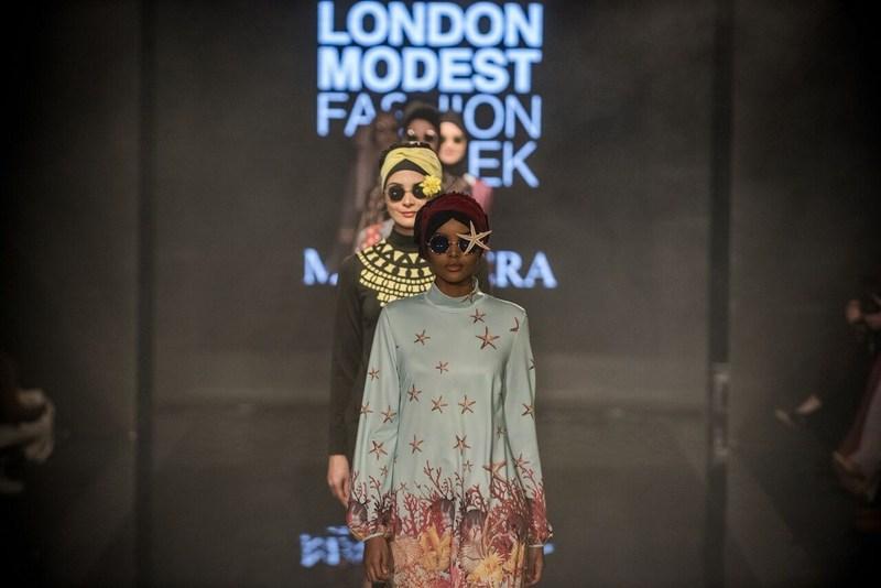 The world's first hijabi model Halima Aden leads on catwalk for Turkish swimwear designer Mayovera at Modanisa London Modest Fashion Week