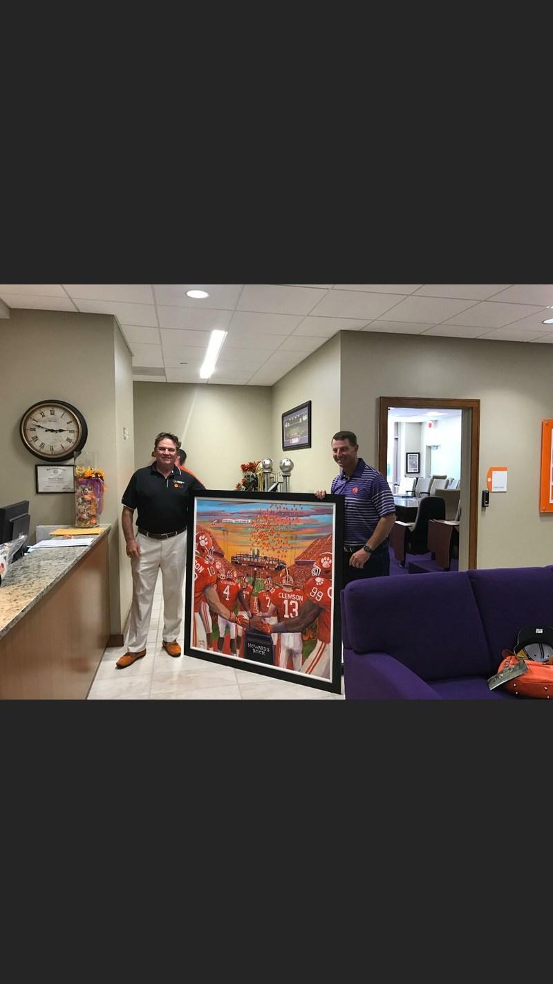 "Thomas Davis presenting ""Redemption"" painting to Clemson University head coach Dabo Swinney"