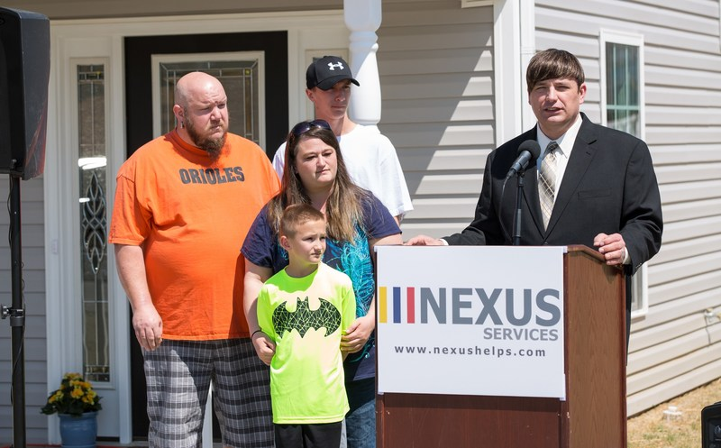 Nexus Services CEO  and President Mike Donovan presents brand-new home to the Truslow family of Augusta County, Virginia through Nexus Services' annual Christmas Miracle Program.