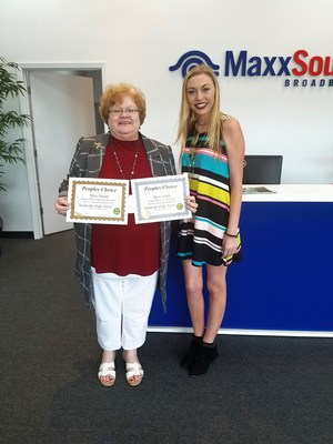 Wendi McMinn, classified and legal representative for the Starkville Daily News, presenting the award to Tonya Thompson, regional general manager at MaxxSouth Broadband.