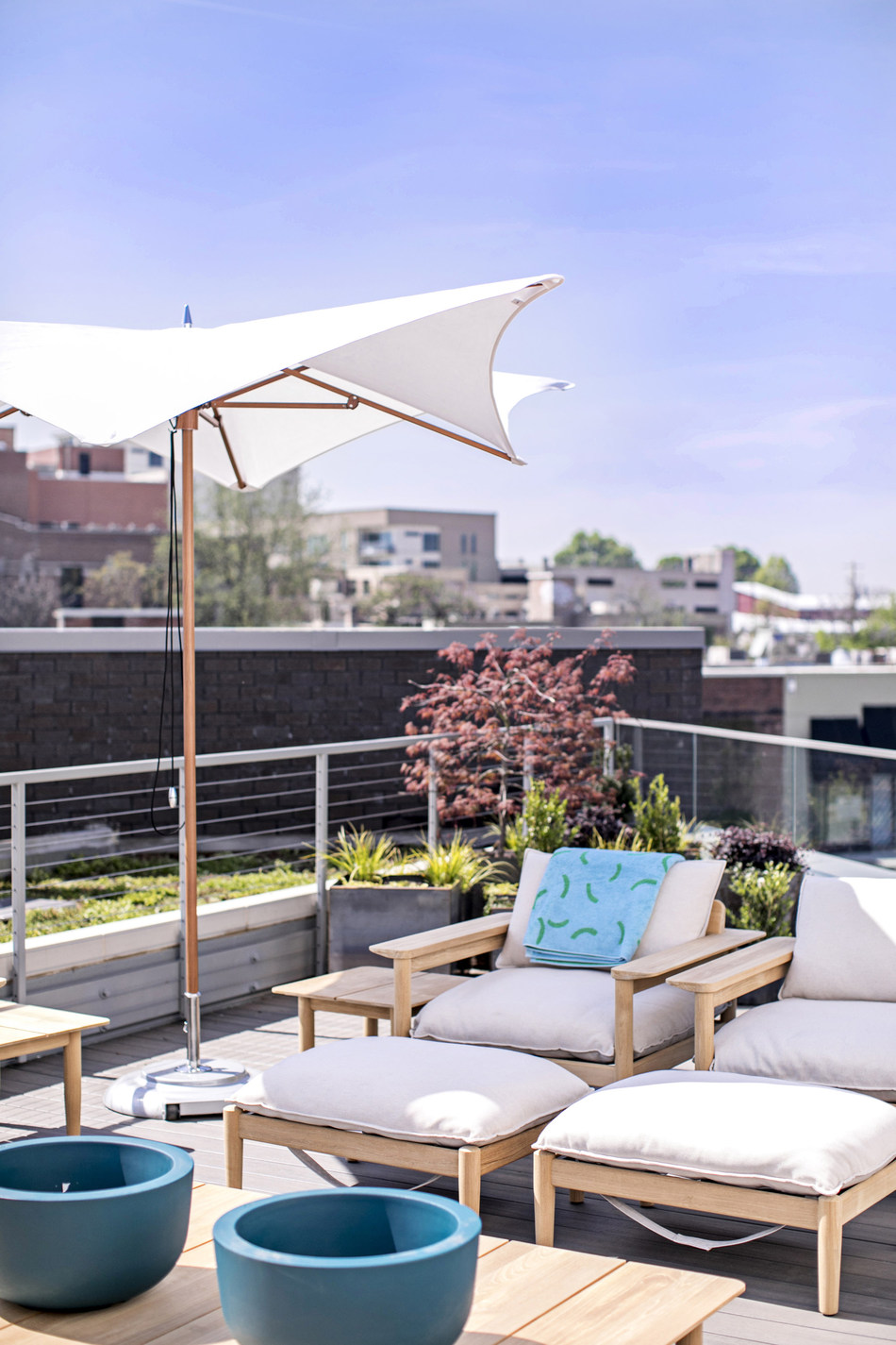 The Outdoor Terrace features collections for dining and lounging al fresco – as well as a skyline view. Photo by Heidi Geldhauser.