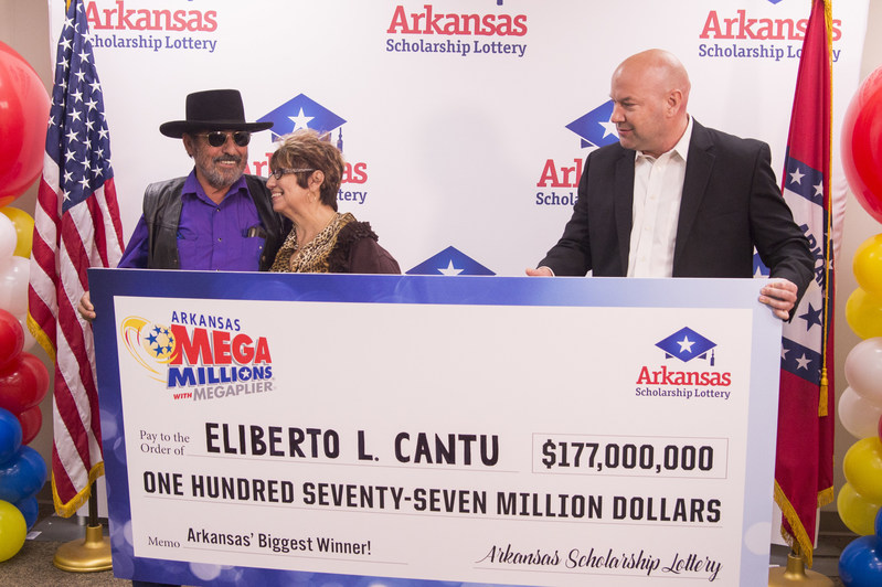 Eliberto and Anita Cantu receive check from Bishop Woosley, Arkansas Scholarship Lottery Director.