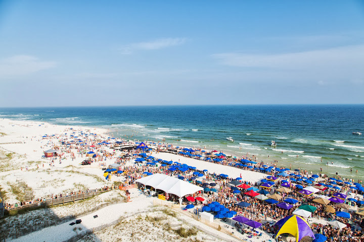 Flora-Bama's 33rd Annual Interstate Mullet Toss & Gulf Coasts' Greatest Beach Party is April 28-30th, 2017 at the world famous Flora-Bama. Thousands of patrons flock to the beautiful white sandy beach that straddles the Alabama/Florida state line between Orange Beach, AL and Perdido Key, FL to toss dead fish (mullet) for charity on the beach behind the iconic Honky Tonk from Florida towards the Alabama state line. Check it out at florabama.com and Facebook.com/florabama.