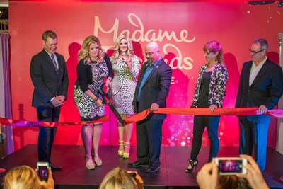 Trisha Yearwood cuts the ribbon at Madame Tussauds Nashville's grand opening event. (Pictured from L to R: Bill Cody, Grand Ole Opry announcer/host; Trisha Yearwood, American country music artist; JeanPierre Dansereau, GM of Madame Tussauds Nashville; Laurel Bennett, VP of Tourism Sales at Nashville Convention & Visitors Corporation; and Gregg Goodman, president of The Mills/A Simon Company.)