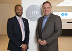 City of Boston Chief of Environment, Energy, and Open Space Austin Blackmon (left) and Blue Cross Blue Shield of Massachusetts SVP of Corporate Communications & Citizenship Jay McQuaide (right) with the LEED Platinum certification Blue Cross received for its Boston headquarters.