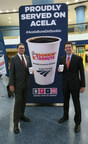 Dunkin' Donuts Hot Coffee is now available on board Amtrak® Acela Express. The partnership kicked off April 19 with a sampling event in New York Penn Station. Pictured left to right is Thomas Hall, Amtrak Vice President, Passenger Experience; and David Hoffmann, President, Dunkin' Donuts U.S. and Canada. (Photo/Stuart Ramson for Dunkin' Donuts)