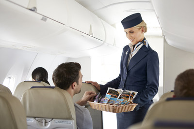 All Porter passengers are offered a variety of complimentary drinks and snack options on board every flight, including free beer and wine. (CNW Group/Porter Airlines Inc.)