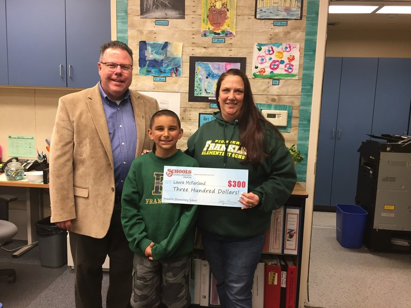 Pictured L-R: Schools Financial Laguna Branch Manager Greg Bainter, 4th grader Ryder Roberts and Franklin Elementary School teacher Laura McFarland.