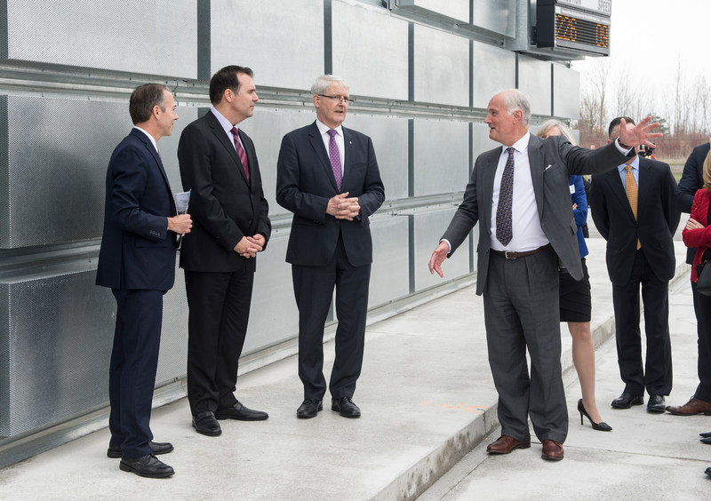 The Honourable Marc Garneau, Minister of Transport joins PortsToronto CEO Geoffrey Wilson and Gene Cabral, Executive Vice President of Billy Bishop Toronto City Airport on a tour of the new Ground Run-Up Enclosure. (CNW Group/PortsToronto)