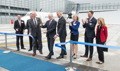 The Honourable Marc Garneau, Minister of Transport joins PortsToronto CEO Geoffrey Wilson and PortsToronto Chair Robert Poirier to cut the ribbon to officially open the new Ground Run-Up Enclosure at Billy Bishop Toronto City Airport. (CNW Group/PortsToronto)