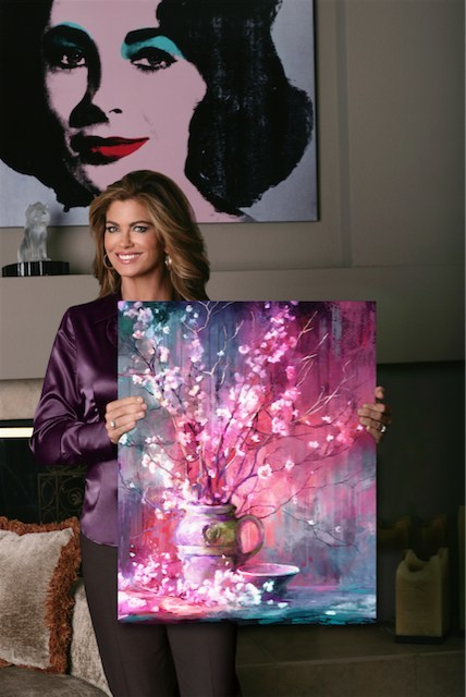 Photographed among the collection of a kathy ireland® Worldwide design studio. The only commercially available item from this image is the artwork held by Ms. Ireland.