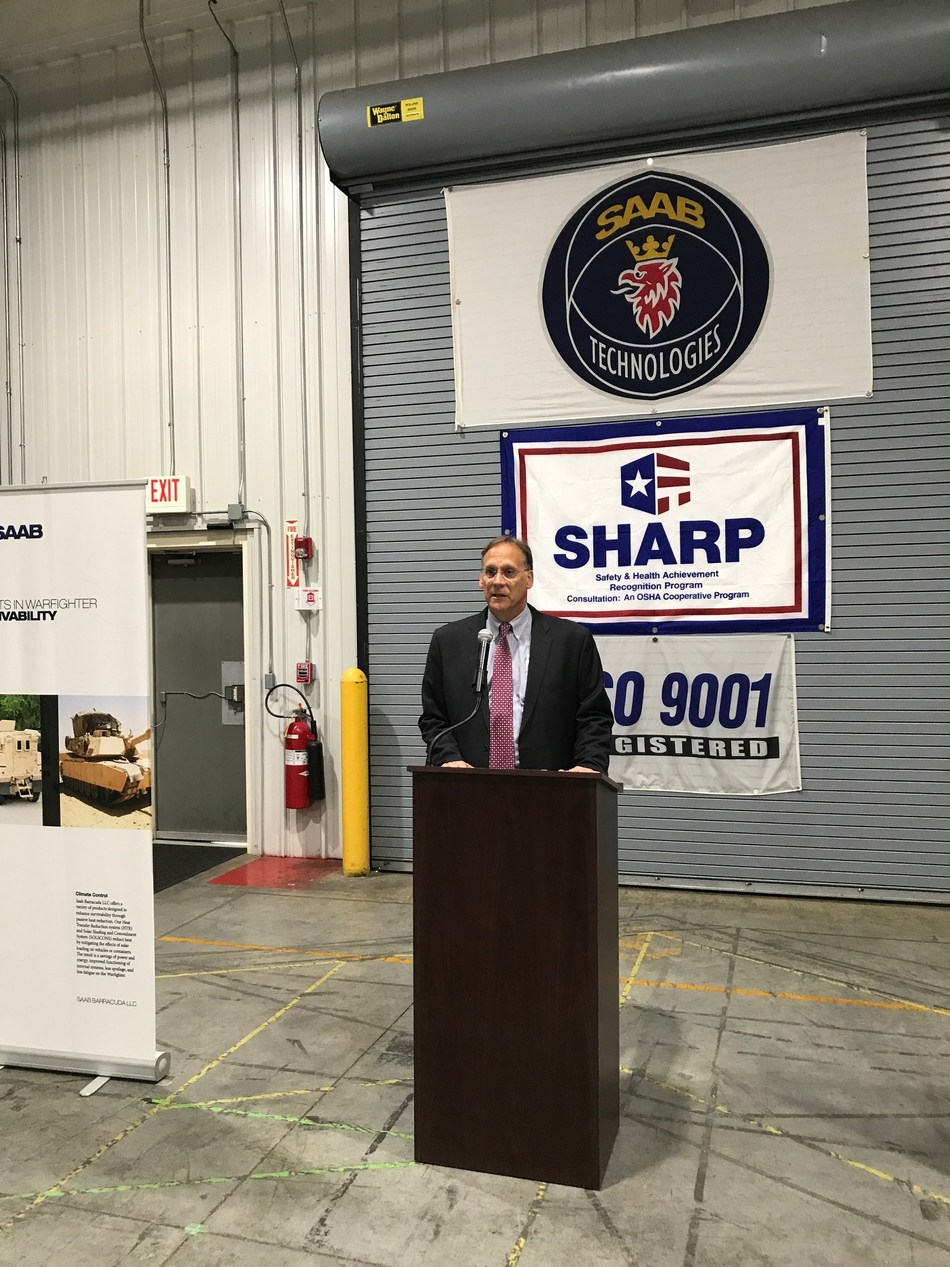Brian Keller, President and General Manager of Saab Defense and Security USA in Lillington, introduces Larry Hall, North Carolina's Veterans and Military Affairs Secretary.