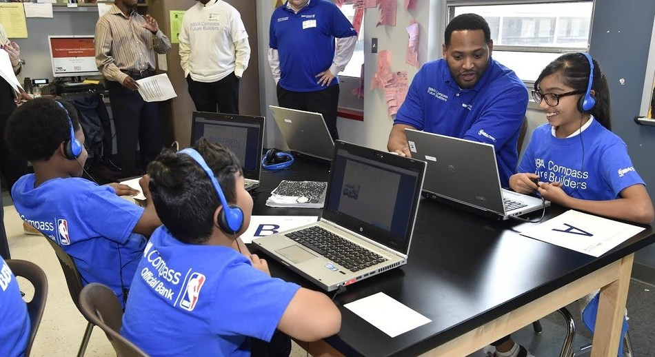 NBA Legend Robert Horry teaches John F. Kennedy Elementary School students about financial literacy as part of a long-standing initiative between BBVA Compass and NBA Cares.