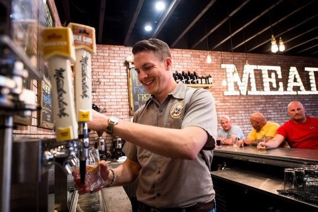 Meadowlark Brewing founder Travis Peterson pouring a beer