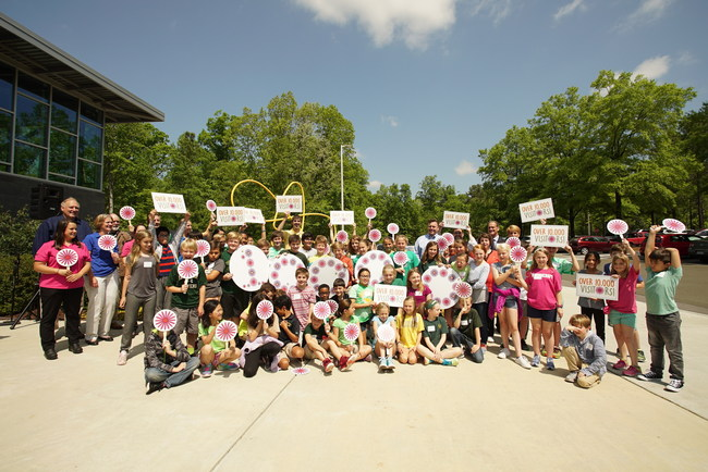Fourth-grade students from Ravenscroft School gathered at the Bayer Bee Care Center to serve as the commemorative 10,000th visitor.