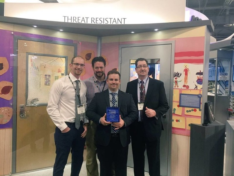Pictured from left: Matt Jacobsohn and Foster Goodrich of School Guard Glass, and Trent Turner and Nelson Kraschel  of ASSA ABLOY accept the Govie Award at ISC West.
