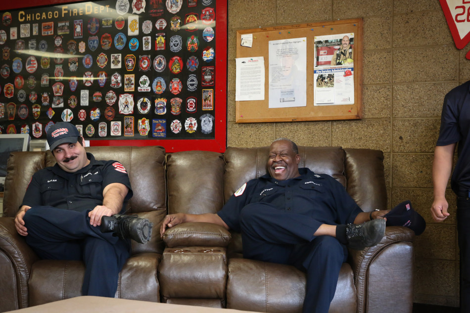 Chicago firemen check out their new furniture which was donated by The RoomPlace on Friday, April 14.