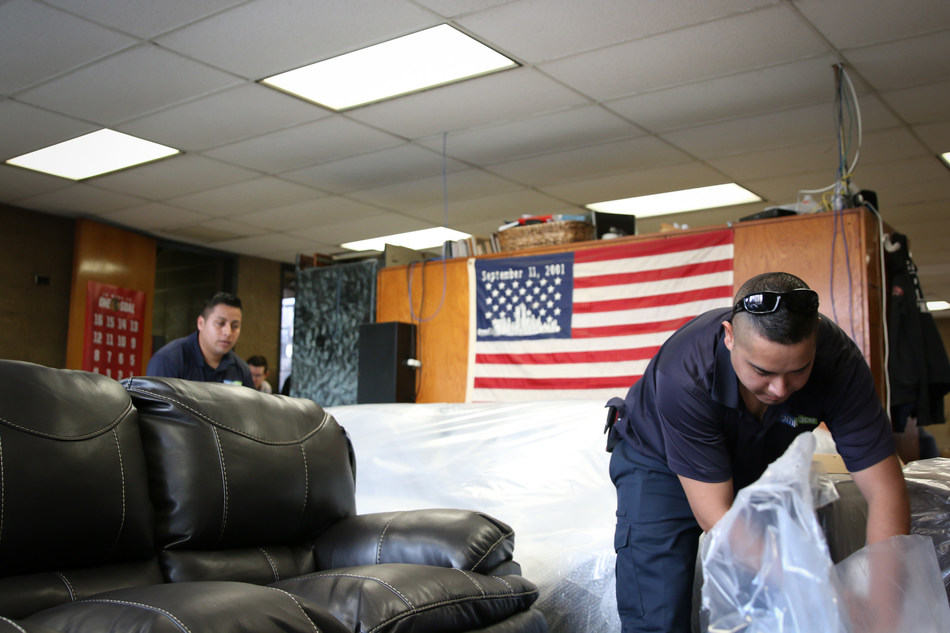 The RoomPlace employees unpack new furniture at a local Chicago firehouse. This is the second consecutive year The RoomPlace is making a sizable donation to honor the service of first responders.