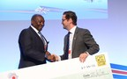 EnergyNet's Managing Director Simon Gosling presenting a cheque to the Energy Minister of Sierra Leone at the Africa Energy Forum 2016, to help fund an off-grid solar project (PRNewsfoto/EnergyNet)