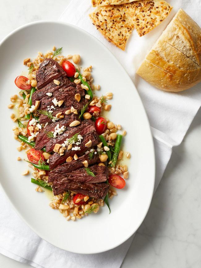Marinated Skirt Steak with farro, haricot vert, grape tomatoes, chick peas, feta, Marcona almonds, dill, toasted spice vinaigrette