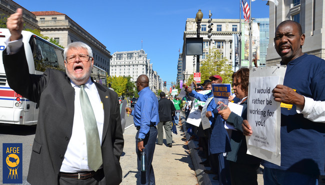 J. David Cox Sr., national president of the American Federation of Government Employees, protests with union activists outside the EPA headquarters in Washington during the 2013 government shutdown.