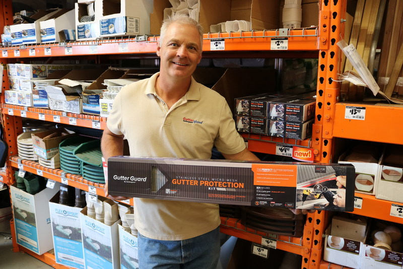Robert Lenney holds his UL certified gutter guard available at HomeDepot.com and participating Home Depot stores.