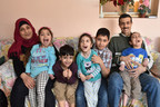 The Alrajab family enjoying their home in Saint John, New Brunswick. From left to right: Mother Shamsa; Sarah, 11; Muhammed, 5; Barraa, 7; Adnan, 12; Abdullah, 9 and Father Nasser.  © Courtesy of Miranda O'Leary Photography (CNW Group/United Nations High Commissioner for Refugees)