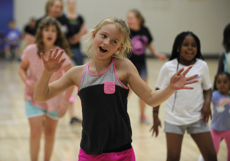 Fourth graders get into their Zumba moves during the Fitness Frenzy Night at Piper Elementary School in Kansas City, Kansas. The event kicked off Every Kid Healthy Week and was supported by a grant from Action for Healthy Kids and ALDI. (Photo by Dave Kaup, Feature Photo Service)