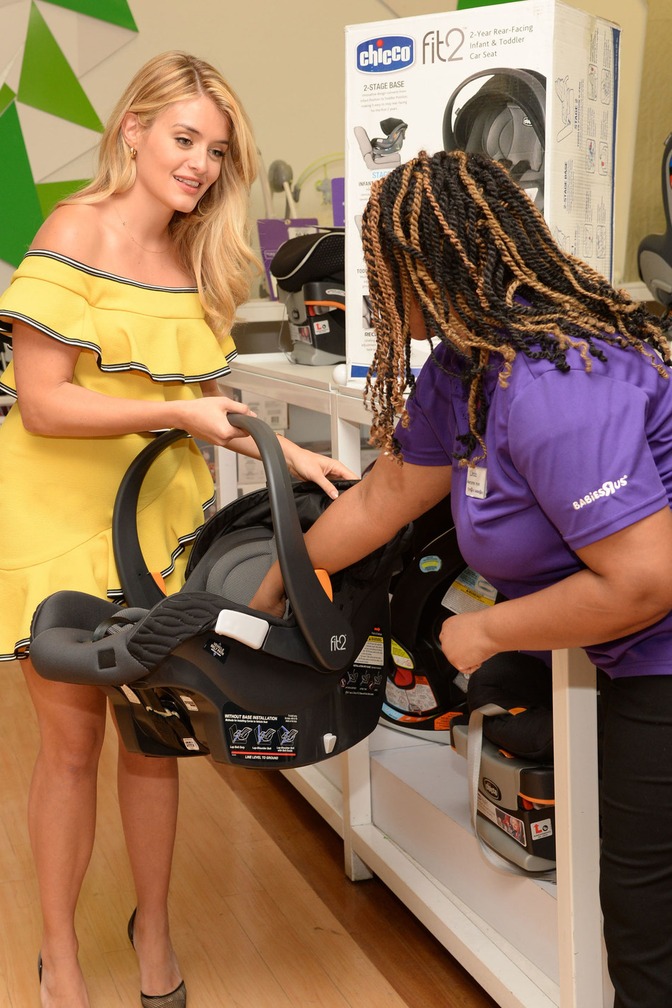 "Daphne Oz, Chicco spokesperson and mom of two, visited the Babies""R""Us Union Square store on April 24 to check out the new Chicco Fit2™ Infant & Toddler Car Seat. Oz is partnering with Chicco to launch TurnAfter2, a national movement designed to keep children rear-facing until at least age two. TurnAfter2 encourages parents to share photos of their kids rear-facing with #TurnAfter2 to inspire positive dialogue around car seat safety. Photo Credit: Michael Simon/Startraksphoto.com"