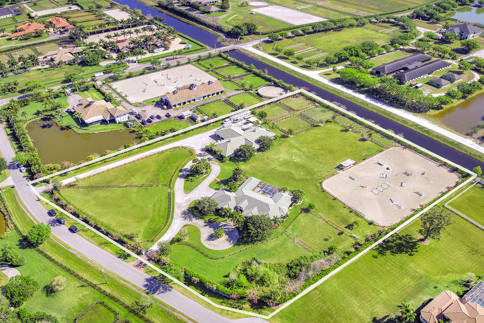 """This 5.5-acre equestrian property in Wellington, FL was sold at luxury auction® on April 21st by Platinum Luxury Auctions. While pricing will not be released until closing, the auction's $2 million Reserve was """"handily exceeded,"""" according to both Platinum and the property seller. The sale extended the luxury real estate auction firm's perfect sales record in the upscale equestrian town to five-for-five. Discover more at EquestrianLuxuryAuction.com."""