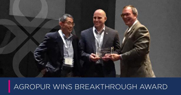 James Carper presents the award to Dr. Fang Ming and Mike Klein of Agropur Ingredients
