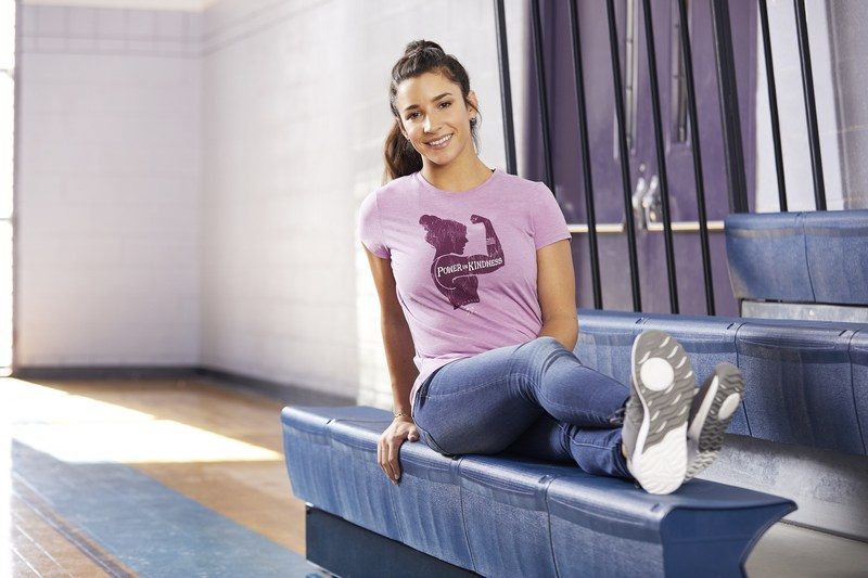 World Champion Gymnast Aly Raisman has partnered with Life is Good to launch new t-shirt collection.