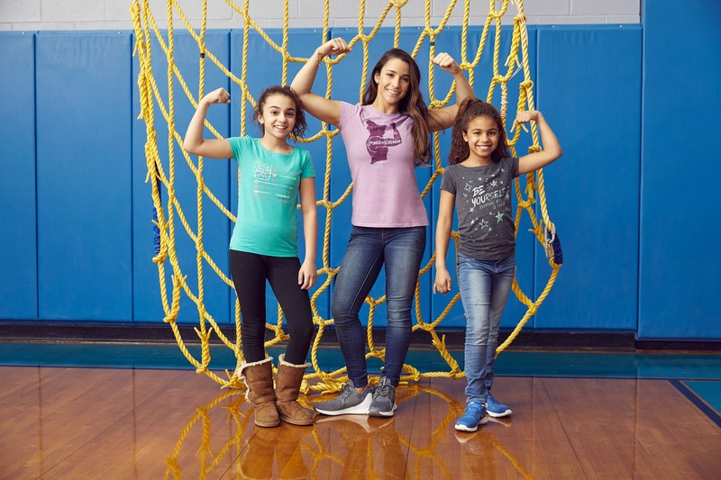Aly Raisman's new t-shirt collection inspires women and girls to be strong, powerful and kind.