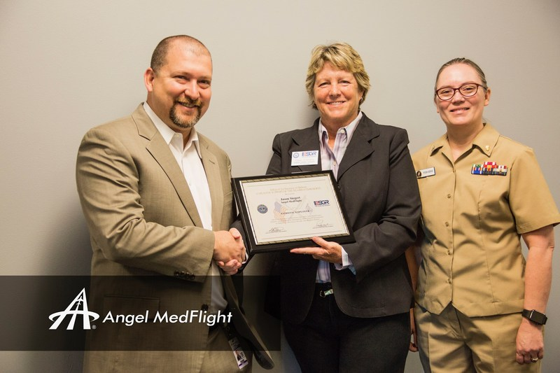 Arizona ESGR representative Carol Smetana presents Jason Siegert, CEO of Angel MedFlight Worldwide Air Ambulance, with the 2017 Patriot Award. Siegert was nominated for the honor by Bambi Pish-Derr DNP, RN, CCRN, CFRN, Angel MedFlight's Director of Clinical Services. Pictured from left: Jason Siegert, Carol Smetana, and Bambi Pish-Derr