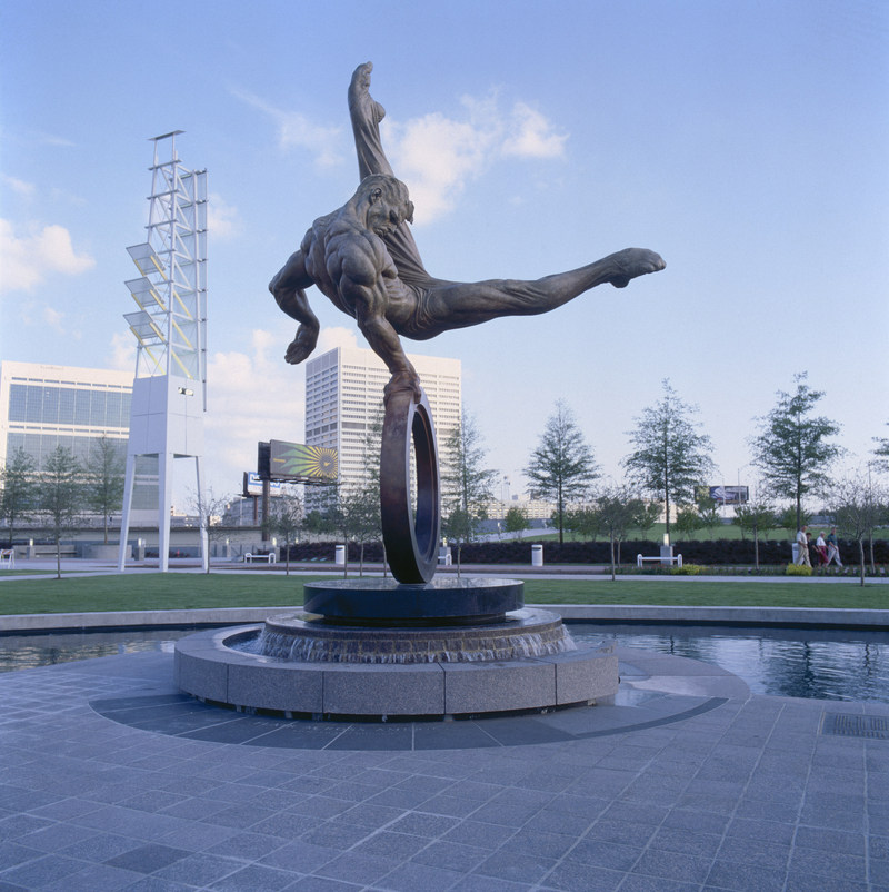 "Created for the 1996 Atlanta Olympics, ""Flair Across America - The Gymnast"" by sculptor Richard MacDonald is a celebration of the triumph of the human spirit - the dedication, tenacity and determination of every individual in the pursuit of excellence. Flair Across America is a the 26-foot high heroic bronze monument that resides permanently at Georgia International Plaza in Atlanta, Georgia."