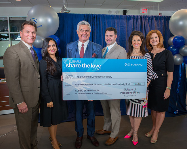 Duane Massa, General Manager at Subaru of Pembroke Pines, Lydia Rodriguez, Campaign Manager at LLS, Craig Zinn, CEO, Zachary, Sales Manager, and Martine Zinn, Corporate Relations Executive at the Craig Zinn Automotive Group, and DeAnn Hazey, Executive Director at The Leukemia & Lymphoma Society.