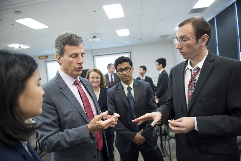 Zachary Newhart (electrical engineering '17) describes a 3-D printed transformer case held by UTC Aerospace Systems Vice President of Engineering for Sensors and Integrated Systems Mauro Atalla (engineering mechanics, Ph.D. '96).