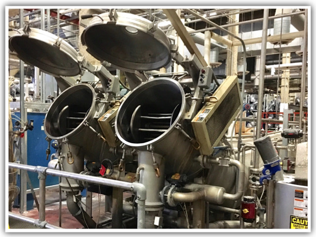 Textile production assets up for sale from Polartec's Lawrence, Mass. plant include this Santex gas-fired open knitgoods dryer